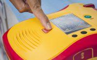 Automated External Defibrillator show finger push button shock